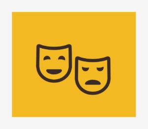 Dwie maski teatralne na żółtym tle.